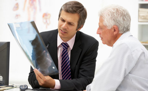 A doctor showing a radiography to his patient
